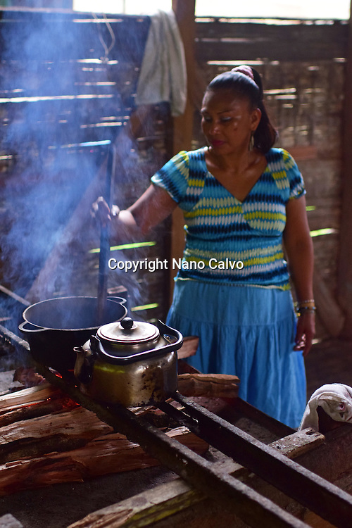 Virgilia, mother of a Bribri family, preparing natural cacao drink at tribe house. <br /> <br /> A day with the Bribri, indigenous people in Lim&oacute;n Province of Costa Rica.