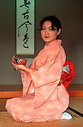HAWAIIAN ISLANDS the East West Center at the University of  Hawaii in Honolulu; Japanese girl preforms a traditional Japanese tea ceremony