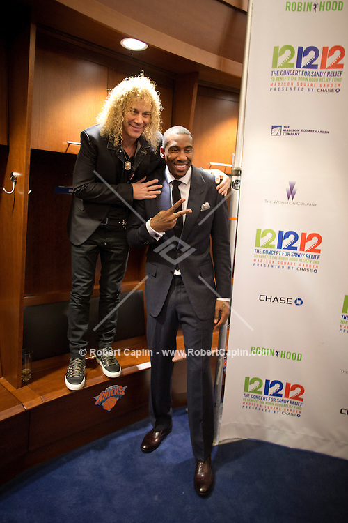 "Amare Stoudemire and David Bryan of Bon Jovi at a meet-and-greet in the Knicks lockeroom. ""12-12-12?, a fundraising concert to aid the victims of Hurricane Sandy, will take place on December 12, 2012 at Madison Square Garden. The concert featured The Rolling Stones, Bon Jovi, Eric Clapton, Dave Grohl, Billy Joel, Alicia Keys, Chris Martin, Bruce Springsteen & the E Street Band, Eddie Vedder, Roger Waters, Kanye West, The Who, and Paul McCartney. All the proceeds went go to the Robin Hood Relief Fund. Robin Hood, the largest independent poverty fighting organization in the New York area, will insure that every cent raised will go to non-profit groups that are helping the tens of thousands.of people throughout the tri-state area who have been affected by Hurricane Sandy...Photo © Robert Caplin.."