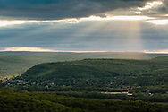 Greenville, New York - Dramatic sunlight and clouds over Port Jervis in a view from Greenville Mountain on May 13, 2015.