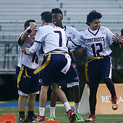 Eric	Anderson celebrates with his teammates after scoring a touch down pass during the inaugural Special Olympics DIAA Unified Flag Football Championship game, Newark Charter defeated McKean 35-28 Saturday, Dec. 03, 2016 at Delaware Stadium in Newark.