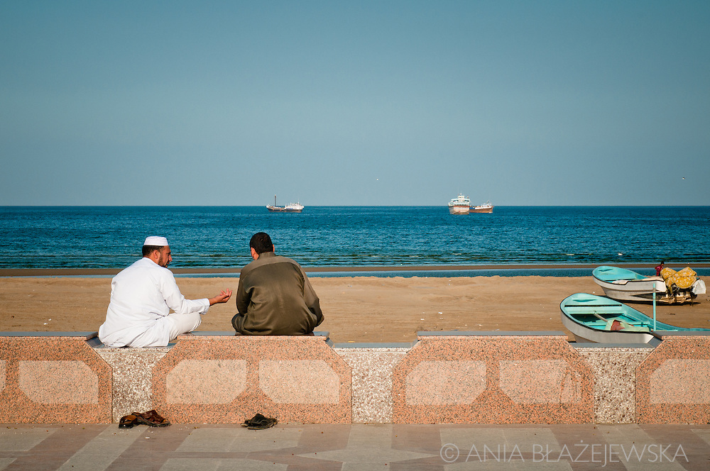 Oman, Sur. Afternoon chat on a corniche in Sur, an Omani town at the Arabian Sea.