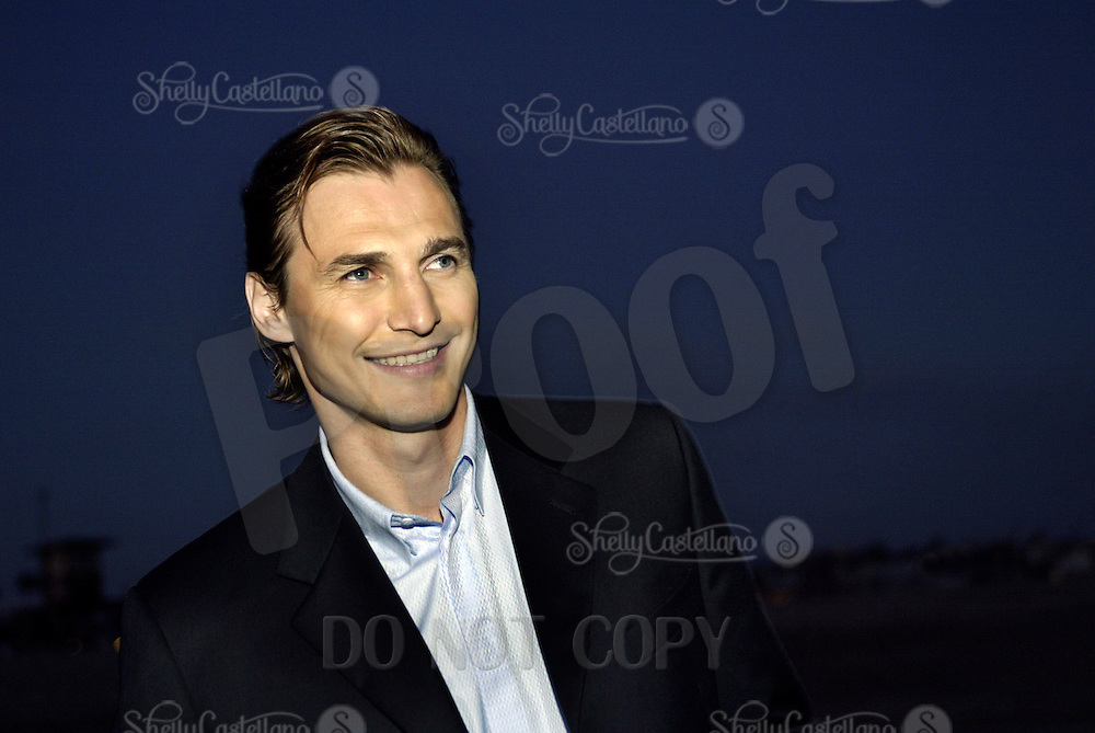 19 August 2003:  NHL Player Sergei Fedorov (RUS) smiles while in Newport Beach wearing a suit during a photoshoot for an American Magazine. Stock, headshot, smile, athlete, suit, portrait.