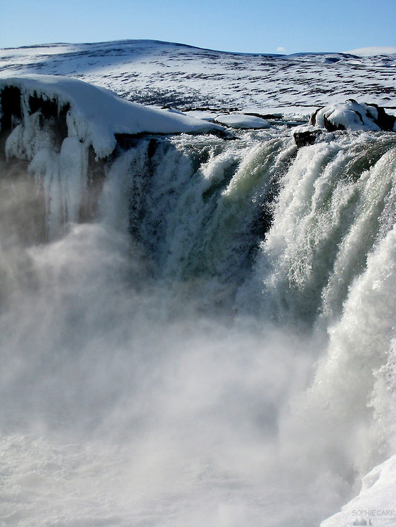 The Goðafoss (Godafoss) waterfall in Northern Iceland in late March - partly still frozen