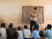 Gulu, Uganda, 2014. A class at the Gulu Support the Children Organization. GUSCO is made of mostly teenage boys and girls who escaped from the LRA. GUSCO offers education and pyschiatric services to reintegrate these people back into civil society.