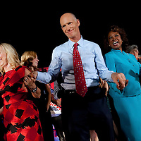TAMPA, FL -- October 25, 2010 -- Republican candidate for governor Rick Scott, center, wife wife, Ann, left, and running-mate Jennifer Carroll greet supporters at a post-debate rally in Tampa, Fla., on Monday, September 25, 2010.  Scott was kicking off his final week of campaigning in the heated race for Florida Governor against Democrat Alex Sink.
