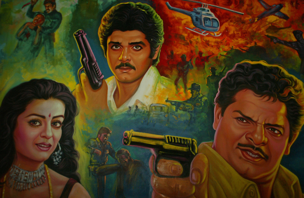 hand made posters of Bollywood movies, now being replaced by machine made Action heros are depicted in a hand painted poster in Bombay, India Dec. 9, 2004. Rather than ripping down a poster once a film has stopped its run, Bombay's dwindling troupe of billboard painters simply cover their last masterpiece with the artwork for next week's big release.