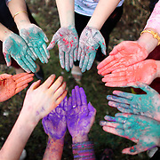 Participants compare their colorful hands during a Holi festival at the Sanatan Dharma Hindu Temple and Cultural Center in Maple Valley on Saturday, March 10, 2012. Holi, the Festival of Colors, is a Hindu festival welcoming spring. It is most well-known for the vibrant bursts of gulal, the powdered dye, that festivalgoers throw on each other. (Joshua Trujillo, seattlepi.com)