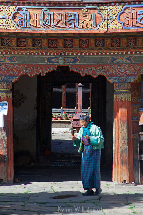 Asia, Bhutan, Bumthang. Bhutanese woman at Jambay Lhakhang, a Buddhist temple dating back to the 7th century.