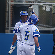 Delaware Outfielder Mike Krusinski (5) celebrates with Delaware Outfielder Calvin Scott (6) after crossing home plate during a regular season baseball game between Delaware and Saint Joseph's at Bob Hannah Stadium Tuesday April 19, 2016, in Newark.