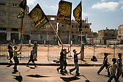 Palestinian children carry Islamic Jihad flags on their way to a martyrs funeral in Rafah, Gaza August 05, 2007. Taking a moderate political position, Hamas is apparently trying to reign in militant Palestinian factions recently such as Islamic Jihad, pressuring them to abandon their public display of weapons and cease rocket and mortar attacks against Israel, presumably to increase potential bargaining power for eventual negotiations with Fatah and/or Israel and to consolidate it's hold of the strip.  ..