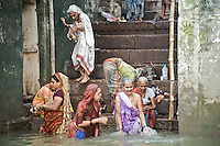This scene reminded me of a Norman Rockwell painting, the Indian version.  While a group of women were bathing in the Ganges River an old woman with a pot in her left hand gingerly descended the steps to join her neighbors.