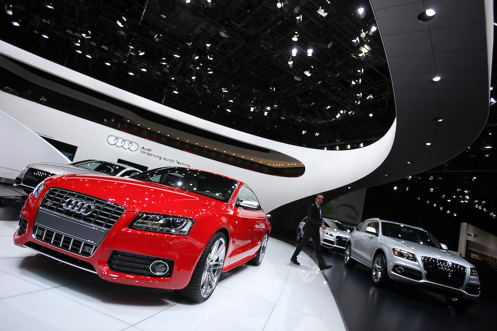 GR --- Detroit, Michigan ---11-01-10--- A man walks through the Audi booth on the first day of the press preview at the North American International Auto Show in Detroit, Michigan, January 10, 2011 .<br /> Geoff Robins AFP