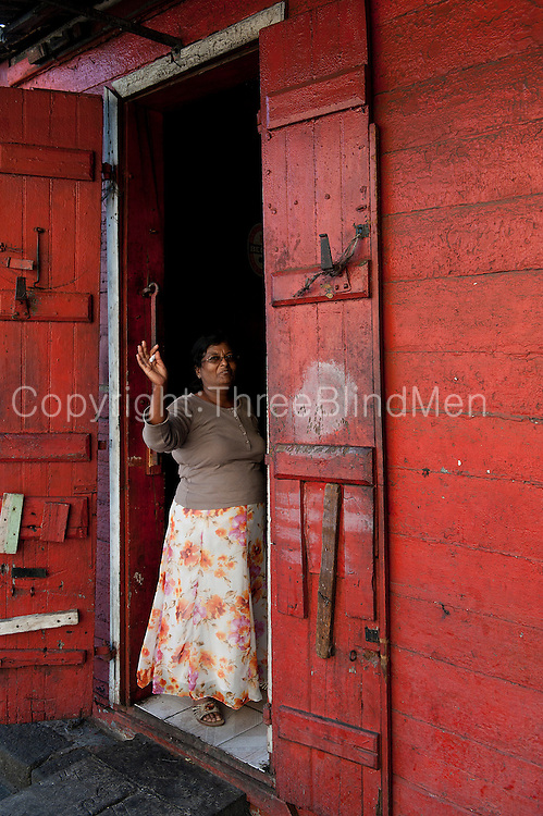 Mauritius, Sandra Vythiyalingam at the door of her small bar in Port Louis.