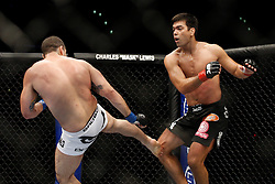 October 24, 2009; Los Angeles, CA; USA; Lyoto Machida (black trunks) takes a kick from Mauricio Rua(white trunks) during their UFC light heavyweight championship bout at UFC 104.   Machida won via controversial unanimous decison .  Mandatory Credit:  Ed Mulholland