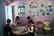 Tunisian Jewish children at play at the Beit Rachel Kindergarten school located in the Hara Kebira neighborhood on the Tunisian island of Djerba on May 25,2016.  Five years after Tunisia's revolution, and a year after three deadly ISIS attacks, the 1,100 Jews in this tiny island community of Djerba say they do not feel threatened living in Tunisia.(Photo by Heidi Levine).