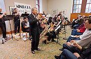"""Vocalist Henry """"Shig"""" Sakamoto performs with the Minidoka Swing Band in the US Bank Room of Multnomah County Library - Central branch, Portland, Oregon. Mr. Sakamoto was a former internee at Minidoka."""