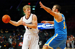 Nov 21, 2008; New York, NY, USA; Southern Illinois Salukis forward Carlton Fay (45) makes a pass by UCLA Bruins forward James Keefe (13) during first half action of the 2K Sports Classic consolation game at Madison Square Garden.
