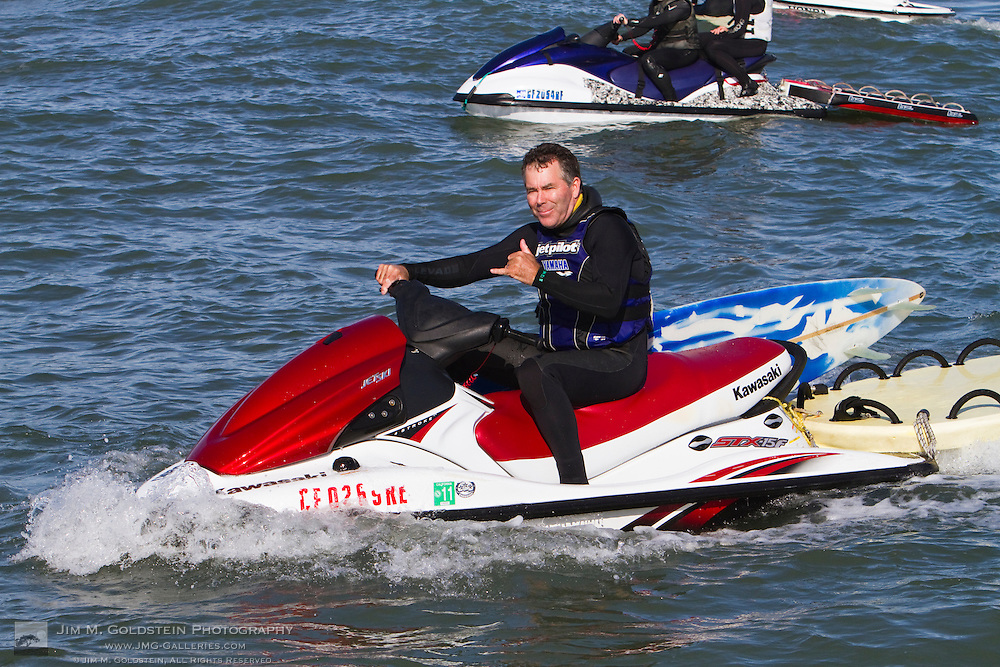 "Jeff Clark gives the ""Hang Loose"" sign from his jet ski at the 2010 Mavericks Surf Contest held in Half Moon Bay, California on February 13, 2010"