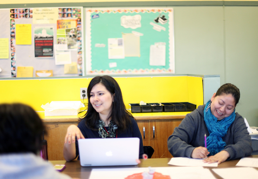 Aurora Jimenez, center, leads a weekly parent-teacher meeting with parents such as Santa Sanchez at King Elementary School on Wednesday, March 7, 2012.