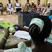 Members' record books are seen at a 'Banking on Change' Village Savings and Loan Association (VSLA) meeting at Dabala Junction in the Volta Region of Ghana on 12 September 2012. Members contribute savings weekly and receive a payout commensurate with their inputs at the end of each year. Members may also access small loans, which many use to support entrepreneurial activities, and they make small insurance contributions which may be drawn upon in the event that an individual member has a financial emergency.