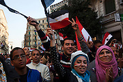 Egyptians continue to celebrate waving flags and singing patriotic songs on a street near Talat Harb square February 12, 2011 in Cairo, Egypt. The day after the revolution toppled the regime of President Hosni Mubarak, Egyptians continued to celebrate and began to focus on rebuilding their country and society. (Photo by Scott Nelson)