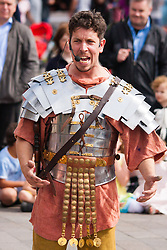 """Granary Square, Kings Cross, London, August 30th 2014.  A """"Roman Centurian"""" entertains the crowds at Granary Square, King's Cross, during Battle Bridge: Boudicca Vs The Romans, which brings alive the ancient history associated with the area. PAYMENT/CONTACT DETAILS: paul@pauldaveycreative.co.uk Tel +44 (0) 7966 016 296 or +44 (0) 208 969 6875"""