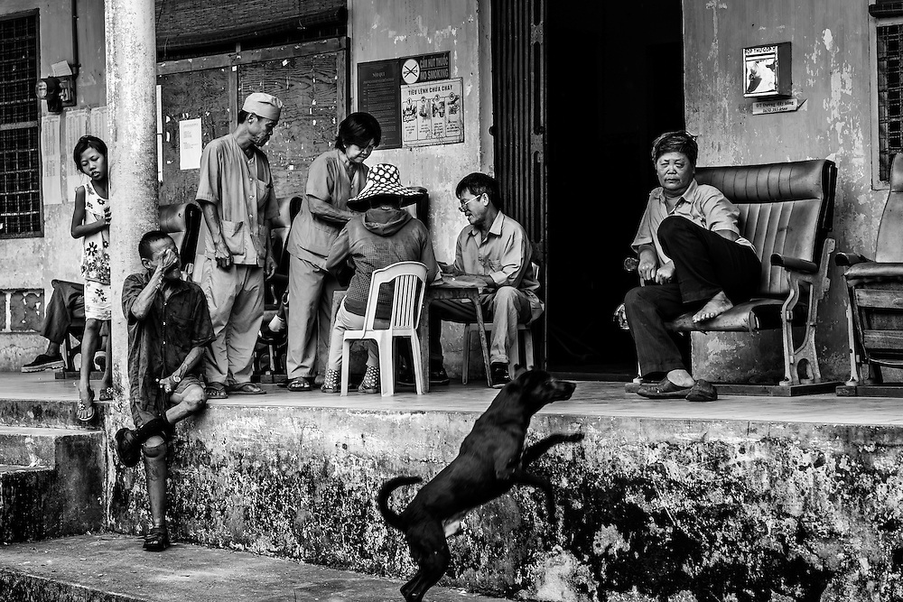 Residents sit outside the canteen at Ben San Leprosy center and hospital, Binh Duong, Vietnam.
