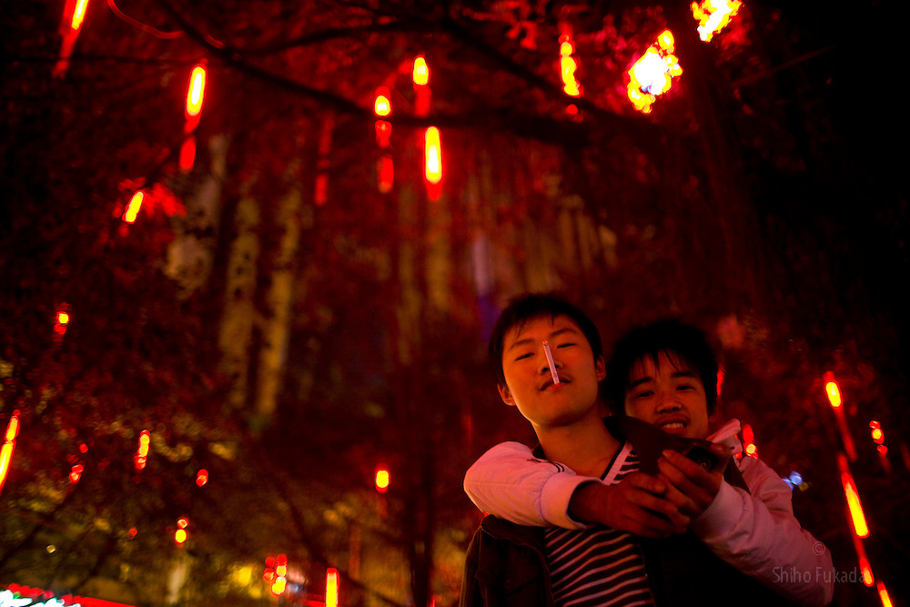 People enjoy night life in Chongqing, China, March 3, 2009.