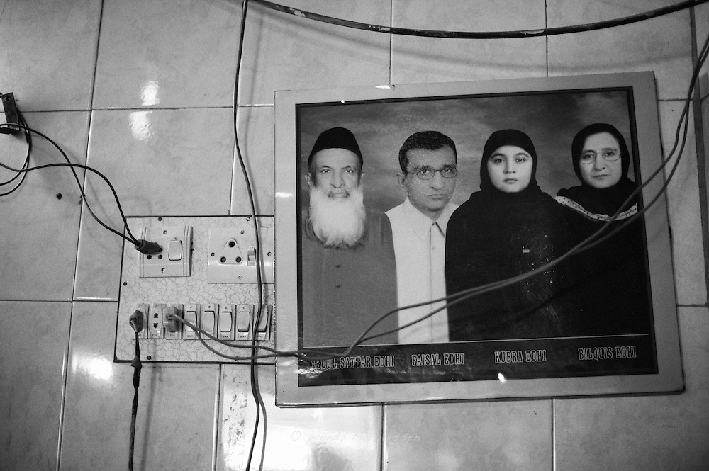 A photograph of the Edhi family. Mr. Abdul Sattar Edhi is the founder of the Edhi foundation, a private organisation run totally on charity. .Providing social services like medical care, emergency services, air ambulances, burial services, mental habitats, old homes, child welfare services, abused women safe houses and training facilities for the disadvantaged..Karachi, Pakistan, 2009