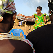 """Anita Sutha, a junior high school teacher by profession, also coordinates a number of women's groups in her area. She is seen with members of a """"susu"""" group - an informal savings and loan club - that she coordinates in her home village of Gbengbee in the Upper West region of Ghana. She also acts as as an assistant to Pognaa Tang I:  a pognaa is responsible, in particular, for the wellbeing of women and children in her area of authority. While the title translates as """"woman chief"""", in practice her authority is  subject to a male chief. The role of the pognamine (plural of pognaa) is being revived after having been suppressed during the colonial era, and they are increasingly seen as a force for development."""