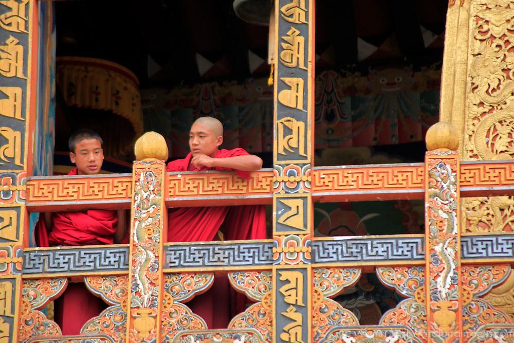 Asia, Bhutan, Punakha. Monks at Punakha Dzong.