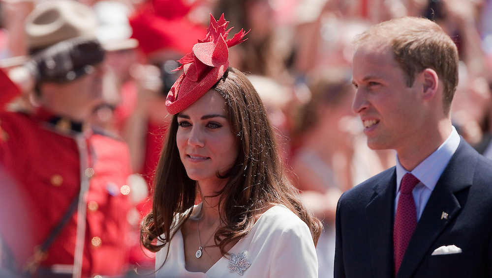 Britain's Prince William and his wife Catherine the Duchess of Cambridge arrive on on Parliament Hill in Ottawa, Ontario, to celebrate Canada Day July 1, 2011. The duke and Duchess are on a nine day tour of Canada, their first official foreign trip as husband and wife.<br /> AFP PHOTO/GEOFF ROBINS