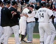 CHICAGO - SEPTEMBER 16:  Jim Thome #25 of the Chicago White Sox hugs his father after hitting his 500th career home run, a walk off home run winning the game, off of Dustin Moseley #58 during the game against the Los Angeles Angels at U.S. Cellular Field in Chicago, Illinois on September 16, 2007.  The White Sox defeated the Angels 9-7.  (Photo Credit Ron Vesely)