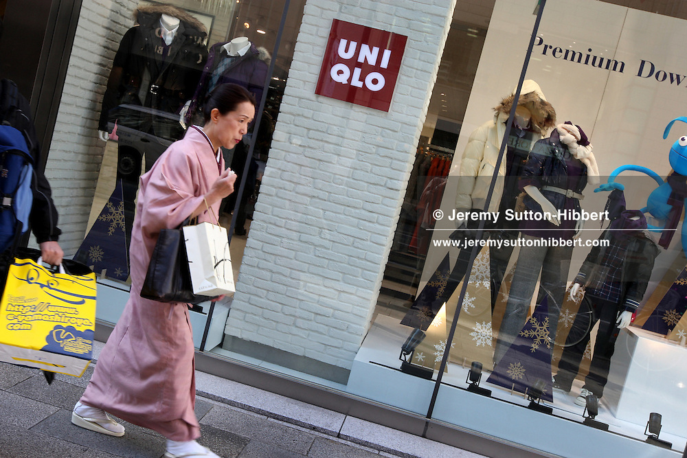 A woman in a kimono walks past the Uniqlo flagship store in Ginza, Tokyo, Japan, Thursday, Nov. 22nd, 2007. Uniqlo owns 760 stores in Japan, with newly opened flagships stores in New York and London, and soon to open a store in Paris.