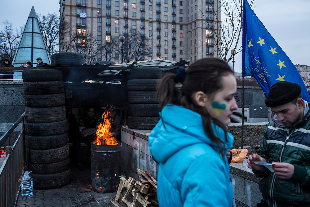 KIEV, UKRAINE - FEBRUARY 23: People visit Independence Square for what has become a traditional Sunday gathering to protest the government on February 23, 2014 in Kiev, Ukraine. After a chaotic and violent week, Viktor Yanukovych has been ousted as President as the Ukrainian parliament moves forward with scheduling new elections and establishing a caretaker government. (Photo by Brendan Hoffman/Getty Images)