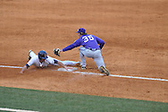 Ole Miss' Sikes Orvis slides safely into third on a passed ball vs. TCU third baseman Jantzen Witte at Oxford-University Stadium in Oxford, Miss. on Friday, February 15, 2013. Orvis would later score on a Will Jamison squeeze bunt. Ole Miss won the season opener 1-0.