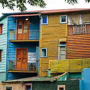 """In La Boca barrio (neighborhood) of Buenos Aires, tourists are attracted by colorful houses, the Caminito pedestrian street, La Ribera theatre, tango clubs, and Italian taverns. La Boca retains a strong European flavor, with many early settlers from Genoa, Italy. It sits at the mouth (""""boca"""" in Spanish) of the Matanza River (or Río Mataderos, or Riachuelo which simply means ?Creek?). La Boca is known among sports fans for La Bombonera stadium (Estadio Alberto J. Armando), home of Boca Juniors, one of the world's best known football (soccer) clubs. As a centre for radical politics, La Boca elected the first socialist member of the Argentine Congress (Alfredo Palacios in 1935) and hosted many demonstrations during the crisis of 2001 in Argentina, South America."""
