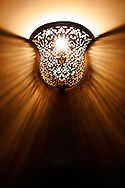 In Moroccan homes or Riads, lights are beautifully set and hand made to set wonderfull textures onto walls like this one in Fes, Morocco on Monday evening, May 28, 2007. (PHOTO BY TIMOTHY D. BURDICK)