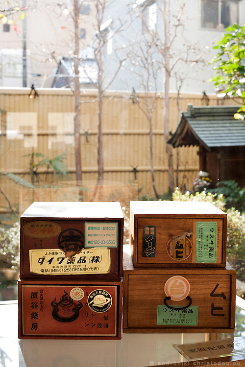 """TOYAMA MEDICINETraditional medicne-box displayed at IKEDAYA YASUBEI SHOTEN a traditional medicine shop in Toyama city.  Medicines manufactured in Toyama spread by medicine peddlers who were called """"Baiyaku-san"""". They traveled all over Japan bringing medicine boxes to their clients, employing a unique business style known as """"Senyo-kori"""" (Use first, and pay later service), in which a box filled with medicines is placed at customer's home free of charge, and later the customer pays for actual consumption. Today, a lot of Baiyaku-san are still active in Japan.Toyama prefecture is located near the center of Japan and is approximately the same distance from the three largest cities in Japan-Tokyo, Nagoya and Osaka. Toyama's pharmaceutical tradition has a more than 300 years history. As it is located on the Japan sea, it is facing China and has been an importer of traditional Chinese medicine knowledge which it developed through the years. There are now approximately 100 manufactures and over 100 factories in Toyama in terms of pharmaceutical products and Toyama prefecture acquires a steady reputation as Japan's medicine manufacturing base."""