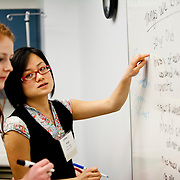 03/11/2011 - Boston, Mass. - First year students Angi Kang, right, and Tess Jasinski write important information on a white board during a demonstration of a simulation exercise during a parents' tour of the Tufts University School of Medicine's Clinical Skills and Simulation Center on Friday, March 11, 2011. (Emily Zilm for Tufts University)