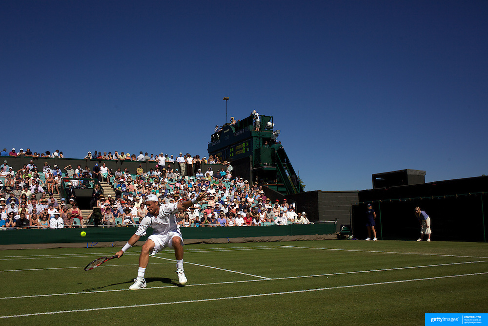 lleyton Hewitt, Australia in action during his three sets to love victory over Robby Ginepri, USA, on a beautiful sunny afternnon during the first round match at the All England Lawn Tennis Championships at Wimbledon, London, England on Tuesday, June 23, 2009. Photo Tim Clayton..