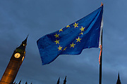 """An EU flag is waved in front of the British parliament as the British government debated US President Donald Trump's state visit to the UK, thousands of protesters gathered in large numbers against the trip which would potentially cost millions of Pounds in security alone, on 20th February 2017, in Parliament Square, London, UK. The visit comes after two online petitions received more than the 100,000 signatures required for such a debate to be considered in Parliament. A petition against the state visit got 1.85m signatures, while one supporting it got 311,000. Campaigners protested against the """"hatred, racism and division that Donald Trump is trying to create"""". Prime Minister Theresa May announced the state visit during her visit to Washington in January."""