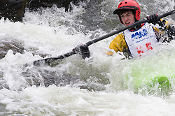 Chris Pelzer of Tipton, Iowa races in the K1 men's open plastic class during the slalom course of the 42nd Annual Missouri Whitewater Championships. Pelzer placed third place in the class. The Missouri Whitewater Championships, held on the St. Francis River at the Millstream Gardens Conservation Area, is the oldest regional slalom race in the United States.