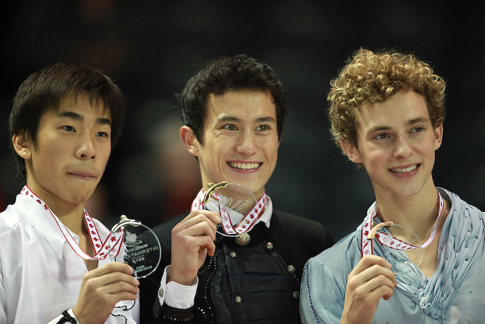 20101030 -- Kingston, Ontario -- Gold medalist Patrick Chan of Canada, centre, poses with Nobunari Oda of Japan, left, the silver medalist and bronze medalist Adam Rippon of the United States during the medal ceremony for the mens competition at Skate Canada International in Kingston, Ontario, Canada, October 30, 2010. <br /> AFP PHOTO/Geoff Robins