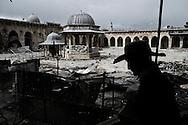 SYRIA, ALEPPO. A rebel fighter pass by the courtyard of the Umayyad Mosque riddled with bullet holes in the old part of Syria's northern city of Aleppo. ALESSIO ROMENZI