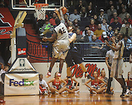 "Ole Miss center Demarco Cox (42)  blocks the shot of Penn State forward Billy Oliver (35) at the C.M. ""Tad"" Smith Coliseum on Friday, November 26, 2010. Ole Miss won 84-71."