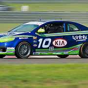 Galati &amp; Jonsson drivers of the No. 10 KIA Forte Koup speeds down the straightaway during qualifying Friday, July 22, 2011, at New Jersey Motorsports Park in Millville New Jersey.<br />