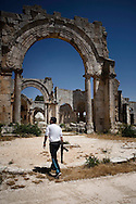 Syria. A member of the Free Syrian Army walks inside the archeological site of Qal'at Sama'an, few kilometers from the village of Dar Ta'Zah.  ALESSIO ROMENZI