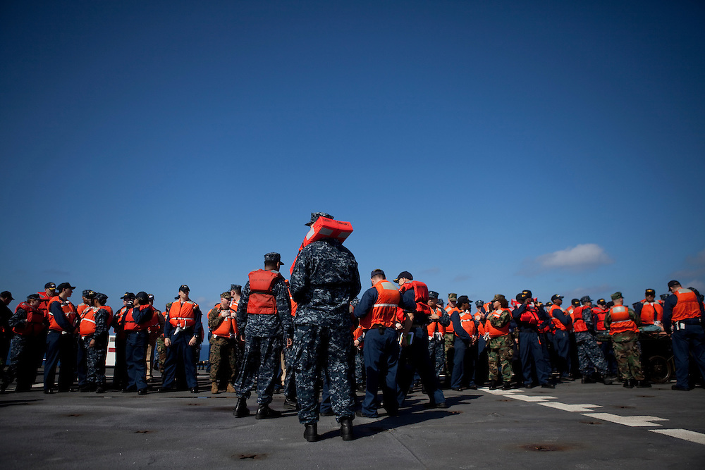 Sailors on board the USNS Comfort, a naval hospital ship, hold an abandon ship drill before their arrival to help survivors of the earthquake in Haiti on Tuesday, January 19, 2010 in the Caribbean Sea.